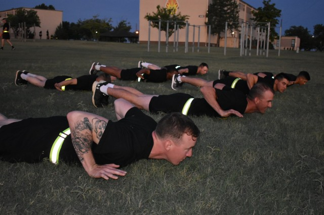 Soldiers from 15th Transportation Company, 100th Brigade Support Battalion, practice the ACPT Release-Push-up on Rowe Field. The Release push-up is designed to test upper body strength and endurance abilities while decreasing the likelihood of injury.