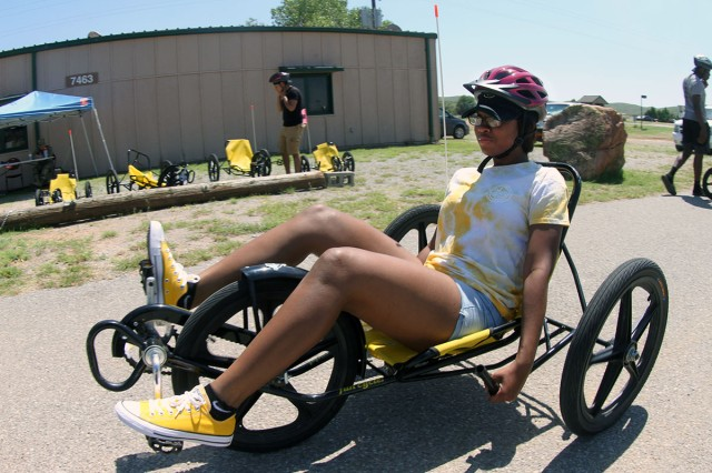 Pvt. Tryonda Hawkins, 2nd Battalion, 18th Field Artillery, rides a recumbent tricycle during BOSS Single Soldier Day Aug. 24, 2018, at the Lake Elmer Thomas Recreation Area on Fort Sill. The annual event was a day to build camaraderie and  resiliency.
