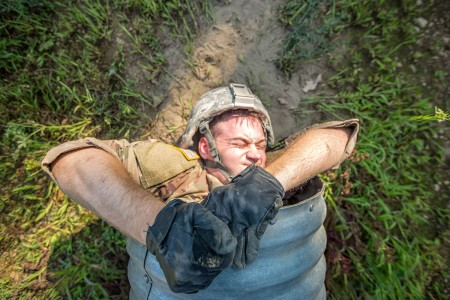 A U.S. Army Reserve Soldier with 376th Engineer Firefighter Detachment, pulls himself from a confined space familiarization tube during a Combat Support Training Exercise at Fort McCoy, Wis., Aug. 13, 2018. The CSTX is a large-scale training event where units experience tactical training scenarios specifically designed to replicate real-world missions.