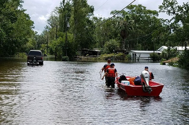In this U.S. Coast Guard file photo from 2017, Coast Guard Flood Punt Teams conduct rescue operations in Jacksonville, Florida, Sept. 11, 2017. The Coast Guard deployed assets and resources from across the country to assist in rescue operations for Hurricane Irma. Fort Benning also felt the effects of Hurricane Irma in early September. (U.S. Coast Guard photo)