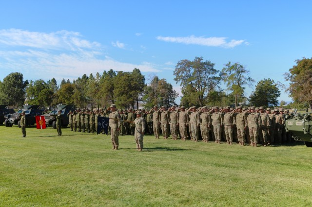 """Soldiers from the Japanese Ground Self Defense Force and American Soldiers from Able Company, 1st Battalion, 17th Infantry Regiment, hold an opening ceremony for their 15-day exercise, """"Rising Thunder 18"""" at the Yakima Training Center, Washington, Aug. 31, 2018. This exercise gives both forces an opportunity to help strengthen allied partnerships, develop readiness and train together as a unified team. (U.S. Army photo by Staff Sgt. Frances Ariele Tejada.)"""