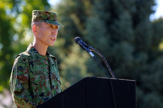 Col. Yoshinori Machinaka, Commander of the Japanese Ground Self Defense Force, addresses Soldiers and special guests during the opening ceremony for Exercise Rising Thunder 18 at the Yakima Training Center, Washington, Aug. 31, 2018. Machinaka shared how this exercise gives participants the opportunity for both forces to learn and train together. (U.S. Army photo by Staff Sgt. Frances Ariele Tejada.)
