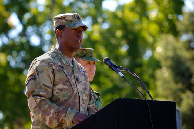 Lt. Col. Donald R. Neal Jr., Battalion Commander of 1st Battalion, 17th Infantry Regiment, addresses Soldiers and special guests during the opening ceremony for Exercise Rising Thunder 18 at the Yakima Training Center, Washington, Aug. 31, 2018. Neal expressed how this is a once in a lifetime opportunity to learn as an allied force, to train hard, and have fun while doing so. (U.S. Army photo by Staff Sgt. Frances Ariele Tejada.)