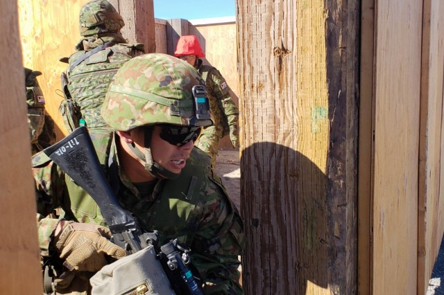 A Soldier from the 1st Infantry Regiment, Japanese Ground Self Defense Force, prepares to exit a room cleared by his squad during an Urban Live Fire training event as part of Exercise Rising Thunder 18 at the Yakima Training Center, WA, Sept. 2. This exercise allows the JGSDF to work on both individual and collective tasks at our premiere training facilities.