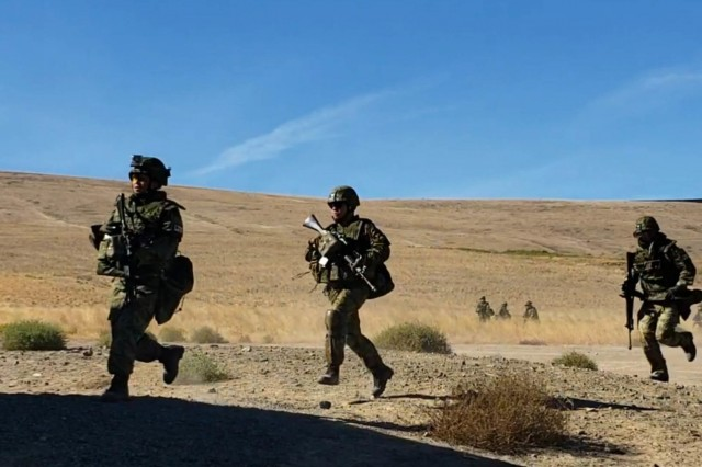 Soldiers from the 1st Infantry Regiment, Japanese Ground Self Defense Force, rush towards their first objective during an Urban Live Fire training event as part of Exercise Rising Thunder 18 at the Yakima Training Center, WA, Sept. 2. This exercise reinforces the importance of readiness in urban environments for both U.S. and Japanese forces.