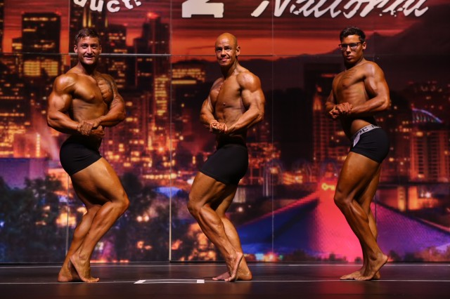 Maj. Danny Kang (center), Far East District plans and operations officer, poses during the 2018 Washington State Open Bodybuilding Championships -- National Physique Committee National Qualifier on Aug. 4, 2018 in Auburn, Washington.