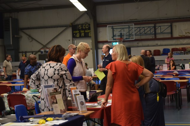 Visitors get some information about the community during the Schinnen Welcome Expo Aug. 18, 2018, in the Schinnen Activity Center in The Netherlands.