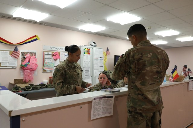 Capt. Jennifer Hawkins, medical provider for 1st Battalion, 12th Infantry Regiment, 2nd Infantry Brigade Combat Team, 4th Infantry Division, reviews paperwork with her Soldiers, Aug. 13, 2018, at the Kandahar Airfield NATO Role III Multinational Medical Unit in Kandahar Airfield, Afghanistan.