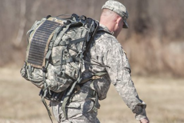 A Soldier tests a photovoltaic Solar Panel Harvester during an energy-harvesting technology demonstration at Fort Devens, Mass.