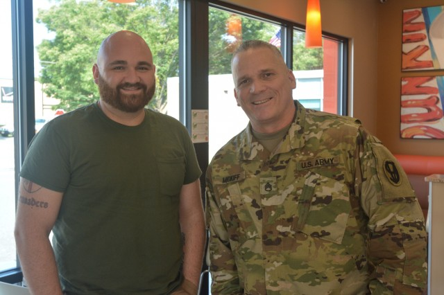 Staff Sgt. Richard Midkiff, right, meets the recipient of his bone marrow transplant, Travis Cimino, 12 years after the procedure. Cimino made a full recovery after receiving the transplant. Midkiff is part of the Department of Defense Bone Marrow program.