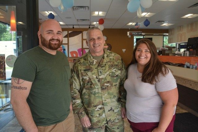 Staff Sgt. Richard Midkiff meets the recipient of his bone marrow transplant, Travis Cimino, and Cimino's fiancee, 12 years after the procedure.