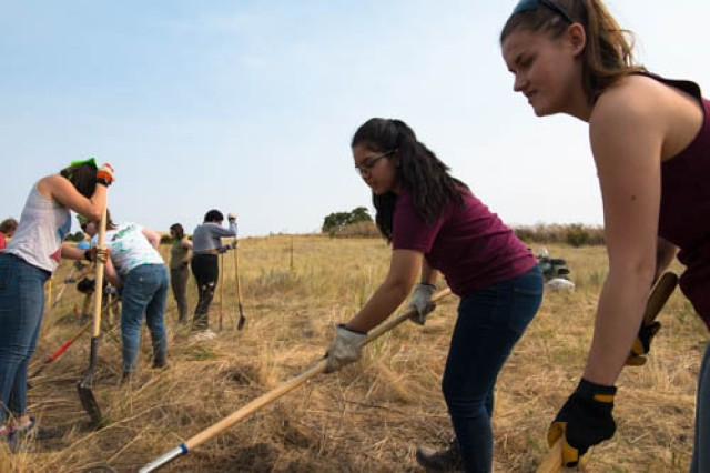 Students at Whitman College, in Walla Walla, Washington are a part of the Summer Community Out-Reach Excursion or SCORE program. Students volunteered to help clean up a small area of land for a future pollinator garden at the Mill Creek and Bennington Lake Project Site.