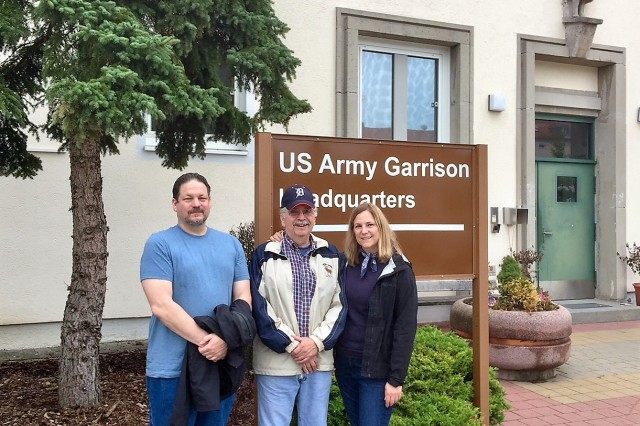 Frank Heining poses in front of the USAG Ansbach headquarters building with his children Karen and Jeffrey during a visit to Barton Barracks in Ansbach Sept. 4, 2018. (Photo by Bianca Sowders, USAG Ansbach Public Affairs)