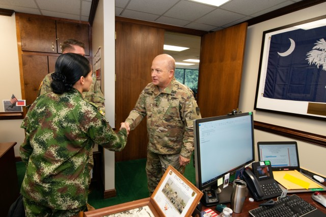 Republic of Colombia Army Judge Advocates meet with U.S. Army Maj. Gen. Robert E. Livingston, Jr., The Adjutant General for South Carolina National Guard, the JAGs are visiting South Carolina to collaborate on ideas during the transformation of the Colombian military justice systems, Columbia, S.C., Aug. 29, 2018. The Colombian Military and the South Carolina National Guard have collaborated through the State Partnership Program since 2012.� Through the SPP, National Guard and partner countries conduct engagements in support of defense security goals in cooperative, mutually beneficial relationships.