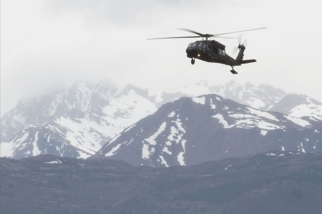 n Alaska Army National Guard UH-60 Black Hawk helicopter approaches Malemute Drop Zone during airborne training at Joint Base Elmendorf-Richardson, Alaska, May 30, 2018. A similar aircraft rescued three people near St. Mary's after a plane crash on Sept. 3, 2018.