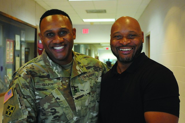 Staff Sgt. Brey Gary and his father, retired Sgt. 1st Class Walter Gary, pose for pictures during the biennial Liquid Logistics Reunion Aug. 24.