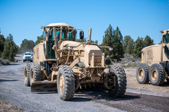 An Oregon Army National Guard Soldier with the 224th Engineer Company, 1249th Engineer Battalion, operates a grader to level out a road surface at Biak Training Center near Redmond, Oregon, June 19, 2018. The 224th Engineer Co. spent their 2018 annual training repairing and resurfacing several miles of gravel road on the 43,000 acres at Biak, which is open to both military training and public recreational use.