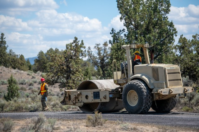 Oregon Army National Guard Soldiers with the 224th Engineer Company, 1249th Engineer Battalion, smooths out a freshly resurfaced road at Biak Training Center near Redmond, Oregon, June 19, 2018. The 224th Engineer Co. spent their 2018 annual training repairing and resurfacing several miles of gravel road on the 43,000 acres at Biak, which is open to both military training and public recreational use.