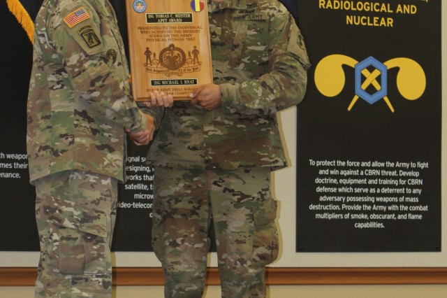 TRADOC Sgt. Maj. Timothy Guden presents Fort Sill Drill Sergeant of the Year Michael Hnat with the 1st Sgt. Tobias Meister Army Physical Fitness Test Award, Aug. 30, 2018, at Fort Sill, Okla.