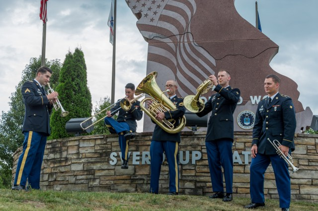 The 399th Army Band's Missouri Brass takes a promotional photo at the FLW rock.