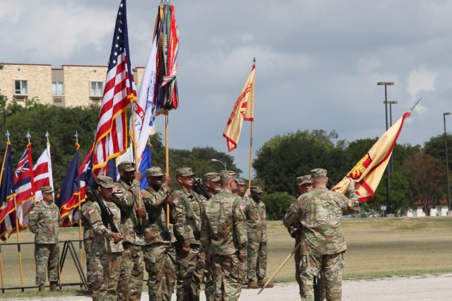 Outgoing IMCOM Commanding General Lt. Gen. Kenneth R. Dahl (facing camera) passes the guidon to Chief of Staff of the U.S. Army Gen. Mark A. Milley during the IMCOM change of command ceremony Sept. 5 at Joint Base San Antonio-Fort Sam Houston.