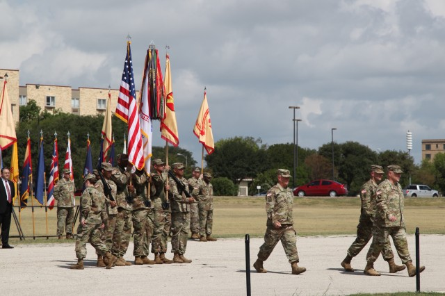 Lt. Gen. Kenneth R. Dahl (walking, center) is accompanied by Lt. Gen. Bradley A. Becker and Gen. Mark A. Milley at the IMCOM change of command ceremony Sept. 5 at JBSA-Fort Sam Houston.