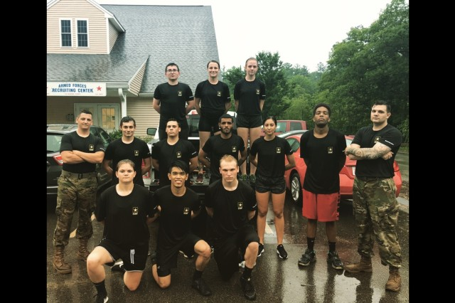 Sgt. Tyler Martin (left) and Sgt. Jason Duffy (right), assigned to the Monson, Massachusetts Southbridge Career Center, pose for a picture with recruits in the rain July 17 during Martin's time as a Special Recruiter Assistance Program volunteer. Martin participated in the Special Recruiter Assistance Program for 30 days. (Courtesy Photo)