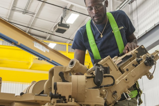 Ashton Cohill performs an inspection of turret components as part of a final inspection for a M1 Abrams tank at Anniston Army Depot. Electronic integrated systems mechanics, like Cohill, are vital to ensuring ANAD's products will function as needed, when needed, in any situation.
