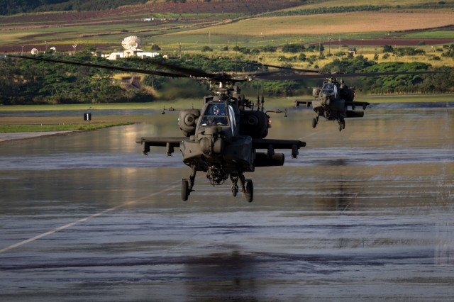 U.S. Army AH-64 Apache helicopter crews, assigned to 16th Combat Aviation Brigade, 7th Infantry Division, land at Wheeler Army Airfield, Hawaii, Jan. 6, 2016, during training with the 25th Combat Aviation Brigade.