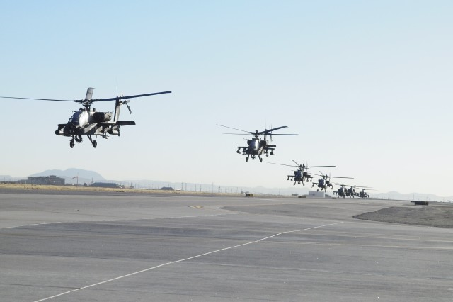Eight AH-64 Apache helicopters with Charlie Company, 1st Battalion, 501st Aviation Regiment, Combat Aviation Brigade, 1st Armored Division lift off from Biggs Army Airfield at Fort Bliss, Texas, Feb. 27, 2014.
