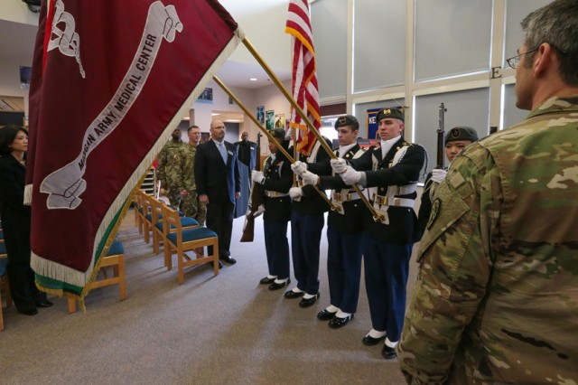 Junior Reserve Officer Training Corps cadets present the colors at the opening of the new school-based health clinic at Rogers High Schoolin 2016.