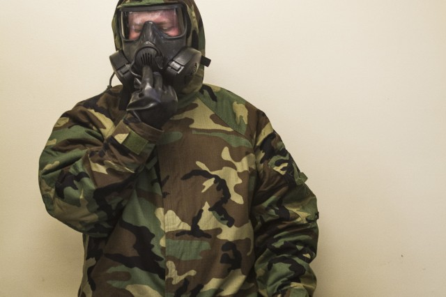 A U.S. Army Soldier, assigned to Company B, 602nd Aviation Support Battalion, 2nd Combat Aviation Brigade, 2nd Infantry Division, prepares to remove his protective mask, to expose himself to chlorobenzylidene malononitrile gas, during chemical, biological, radiological and nuclear defense training on Camp Humphreys, Republic of Korea, May 27. CS gas can be used by military and police forces as a form of non-lethal crowd control. (U.S. Army photo by Spc. Adeline Witherspoon, 20th Public Affairs Detachment)