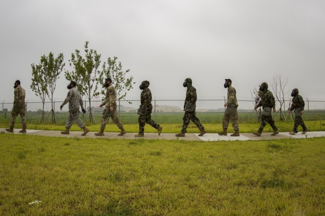 Soldiers assigned to Company B, 602nd Aviation Support Battalion, 2nd Combat Aviation Brigade, 2nd Infantry Division, prepare to enter the gas chamber during chemical, biological, radiological and nuclear defense training on Camp Humphreys, Republic of Korea, May 27. The training familiarizes Soldiers with their protective equipment in the event of a CBRN incident. (U.S. Army photo by Spc. Adeline Witherspoon, 20th Public Affairs Detachment)