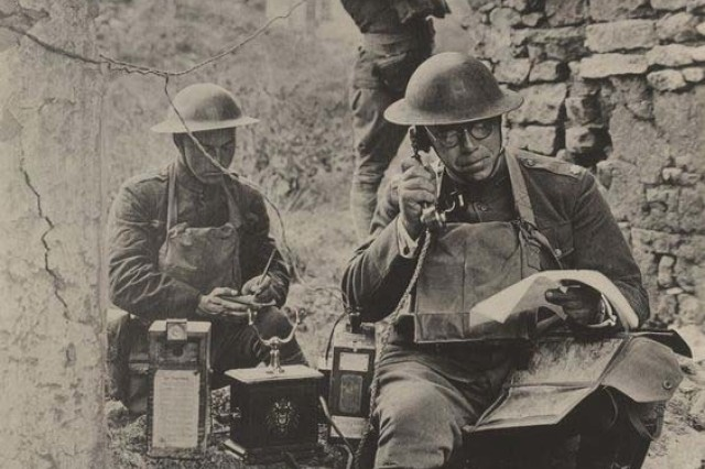 "Lt. Col. R.D. Garrett, the 42nd ""Rainbow Division"" signal officer, tests a German telephone captured from the enemy during the Saint-Mihiel Offensive on Sept. 19, 1918 at Meuthe et Moselle, France."