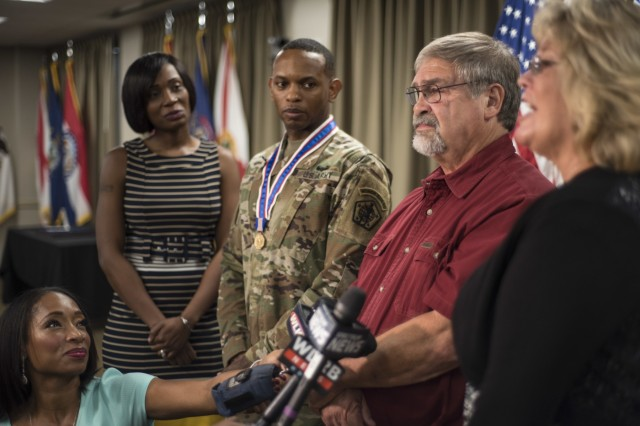 Burl (Doug) Bowling, who Sgt. 1st Class Mario King saved from a burning truck, speaks during the Soldier's Medal ceremony for King, Sept. 7, 2018.