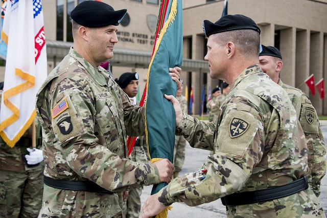 "Incoming U.S. Army Operational Test Command (USAOTC) Commander Brig. Gen. William D. ""Hank"" Taylor (left), receives the unit colors from Maj. Gen. Joel K. Tyler, commander of USAOTC's higher headquarters, the U.S. Army Test and Evaluation Command at Aberdeen Proving Ground, Md., during USAOTC change of command ceremonies Thursday, Sept. 6 at West Fort Hood, Texas."
