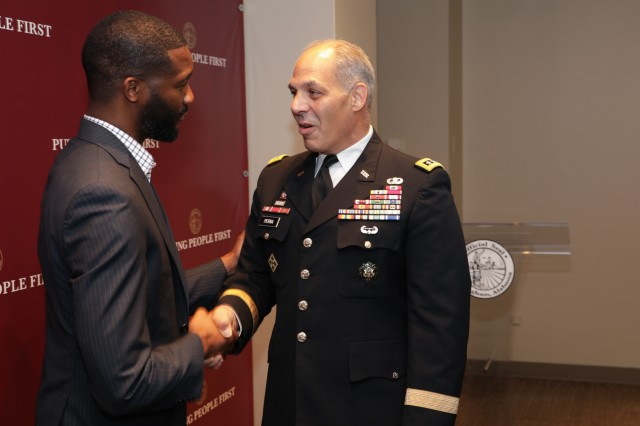 Birmingham, Ala., Mayor Randall Woodfin and Gen. Gus Perna, commander of the Army Materiel Command, meet at the Mayor's office during the Aug. 22 Meet Your Army event in the Magic City.