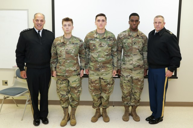 The Army Materiel Command's command team -- Gen. Gus Perna and Command Sgt. Maj. Rodger Mansker -- with three leading ROTC cadets at the University of Alabama in Birmingham. Perna spoke to about 30 UAB ROTC cadets during this Meet Your Army visit Aug. 22.