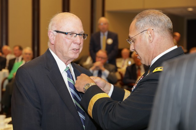 Gen. Gus Perna, commander of the Army Materiel Command, pins a Vietnam War pin to the lapel of a Vietnam veteran during this presentation at the Rotary Club of Birmingham luncheon as part of the Aug. 22, 2018, Meet Your Army event. About 12 Rotarians received a pin from Perna the luncheon. Perna shared with the Rotarians the need for community support of the Army, its veterans and its recruiting efforts.