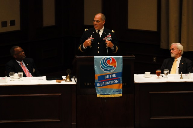 Gen. Gus Perna, commander of the Army Materiel Command, speaks at the Rotary Club of Birmingham during a Meet Your Army event Aug. 22, 2018. The day of activities was meant to build a stronger relationship between Birmingham and the Army through understanding, and sharing of values and goals. At left is the Rotary president Dr. Eric Jack and at right is Dr. Joe Fitzgerald, the civilian aide to the Secretary of the Army.