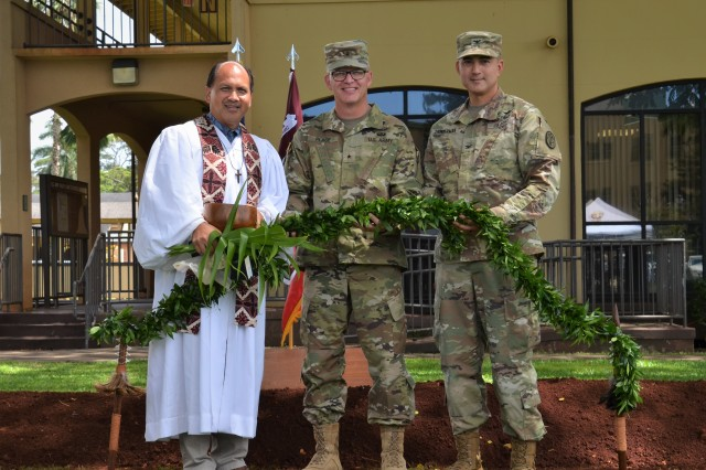 Kahu Kordell Kekoa (left), Brig. Gen. Michael Place, Deputy Commanding General, RHC-P (center), and Col. Dave Zimmerman, commander, USAHC-SB participate in the untying of the maile lei during the groundbreaking for a new medical annex at the U.S. Army Health Clinic-Schofield Barracks.The 76,500-square-foot facility will house dental, behavioral health and physical therapy clinics into one location, and allow for additional renovations across the campus with the goal of enhancing support to service members, their families, and units on Oahu. (Photo by John Ciccarelli)