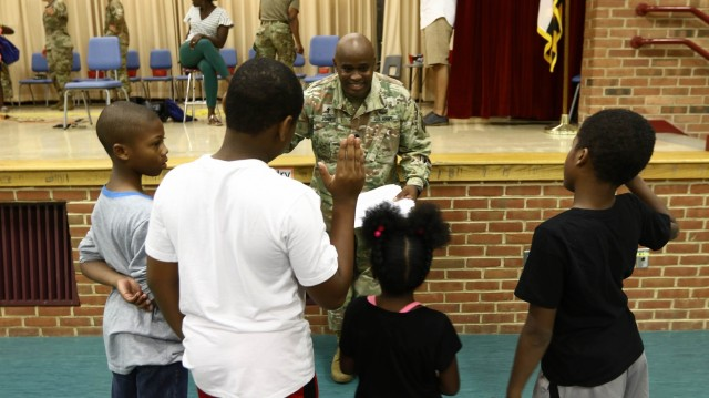 Haircuts and high fives: 20th CBRNE Soldiers welcome area elementary school students back to class