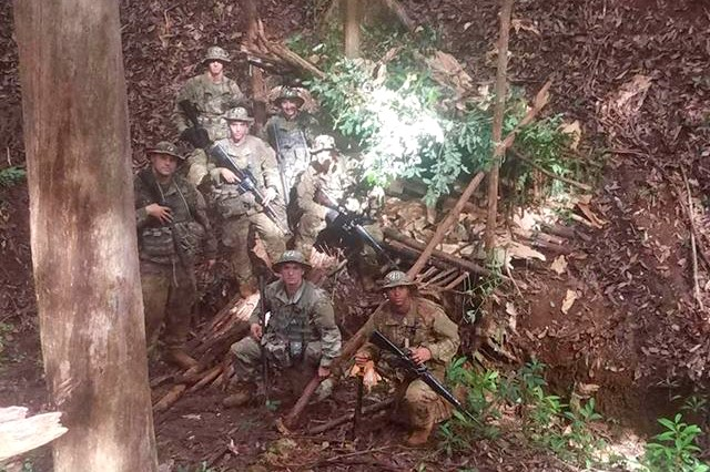 Members of 2nd squad, class 07-18, learn how to build a shelter in case of a survival situation during the 25th Infantry Division's Jungle Operations Training Course, July 24 to Aug. 9, at East Range Training Center, Schofield Barracks, Hawaii.
