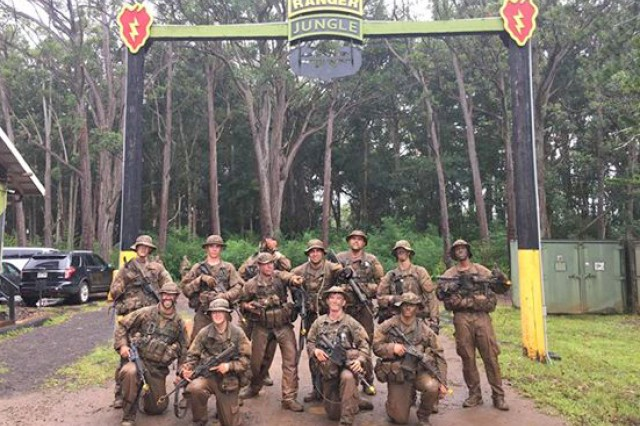 Members of 2nd squad, class 07-18 complete a squad movement called the Green Mile, the last event needed to graduate the 25th Infantry Division's Jungle Operations Training Course at East Range Training Center, Schofield Barracks, Hawaii, on Aug. 9.