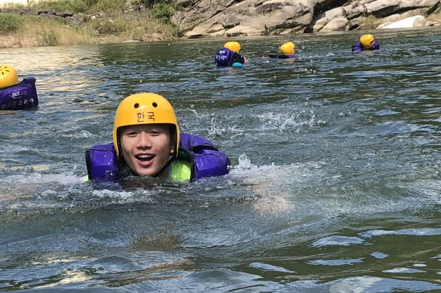 CHERWON, Republic of Korea -- KATUSA Pfc. Kim, Hyun Rae, native of Sejong City, and supply specialist assigned to Headquarters Support Company, 2nd Infantry Division/ROK-U.S. Combined Division disembarks from the raft to enjoy swimming in the Hantan River. The 2ID/RUCD Unit Ministry Team hosted a whitewater rafting trip for members of the Warrior Division to encourage team building, resilience, and spiritual fitness on the Hantan River Sept. 7.