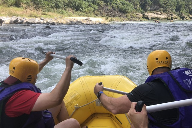 CHERWON, Republic of Korea -- Members of 2nd Infantry Division/ROK-U.S. Combined Division negotiate the intense rapids of the Hantan River. The 2ID/RUCD Unit Ministry Team hosted a whitewater rafting trip for members of the Warrior Division to encourage team building, resilience, and spiritual fitness on the Hantan River Sept. 7.