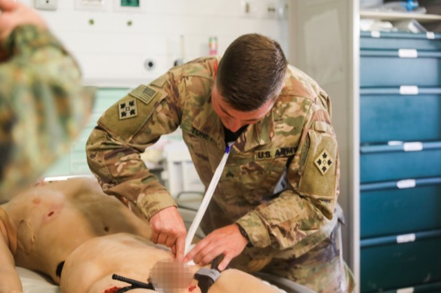 U.S. Army Sgt. James Toney, a healthcare specialist assigned to 1st Battalion, 12th Infantry Regiment, 2nd Infantry Brigade Combat Team, 4th Infantry Division, demonstrates how to care for a wound, Aug. 20, 2018, during tactical combat casualty care in Kandahar Airfield, Afghanistan. (U.S. Army photo by Staff Sgt. Neysa Canfield)