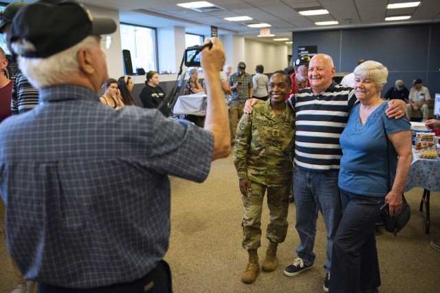 A pair of volunteers pose for a photo with a Soldier at the Portsmouth International Airport at Pease, N.H., Sept. 7, 2018.