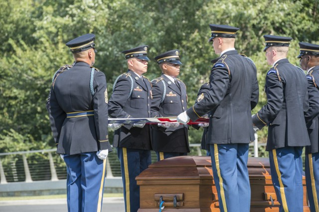 "Two caissons from the 3rd U.S. Infantry Regiment (The Old Guard) Caisson Platoon, The U.S. Army Band ""Pershing's Own,"" and Soldiers from The 3rd U.S. Infantry Regiment conduct military funeral honors with funeral escort for two unknown Civil War Union Soldiers in Section 81 of Arlington National Cemetery, Arlington, Virginia, Sept. 6, 2018."