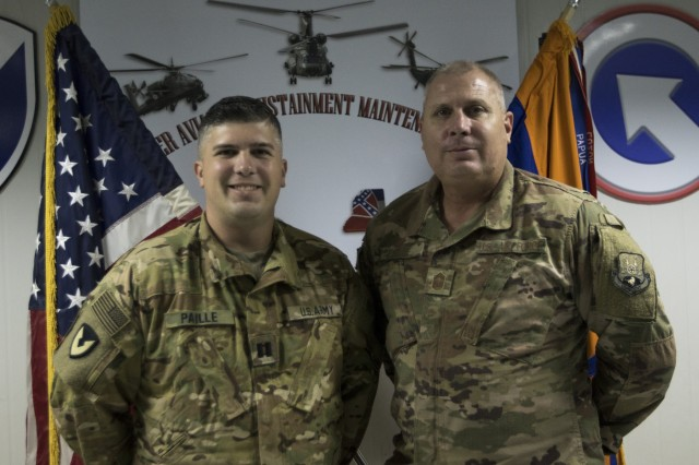 U.S. Air Force Chief Master Sgt. Andre Paille, a project manager with the 214th Engineering Installation Squadron, Louisiana Air National Guard, attached to U.S. Air Force Central, and his son U.S. Army Capt. Joshua Paille, commander of Headquarters and Headquarters Detachment, 1109th Theater Aviation Sustainment Maintenance Group, attached to Task Force 22, had an opportunity to spend a day together at the airfield where Joshua Paille works at Camp Arifjan, Kuwait, Sept. 1, 2018.